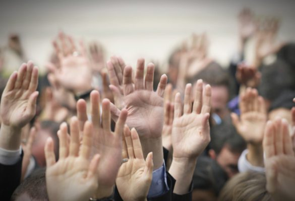 A group of people raised their hands